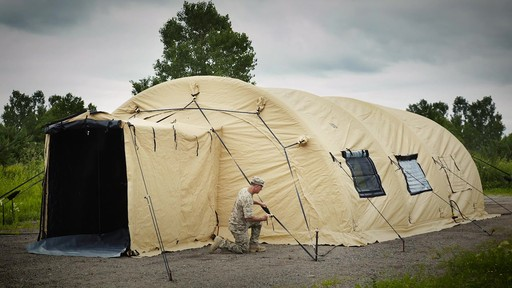 US Military Issue AirBeam Shelter 32' x 20' New - image 1 from the video