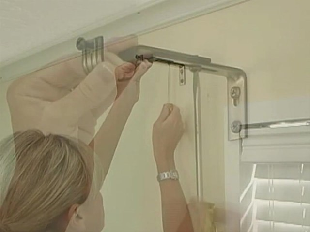 How to Install Window Drapes Video - Laura Ashley Grommet Drapery Panels - Blinds.com DIY - image 6 from the video