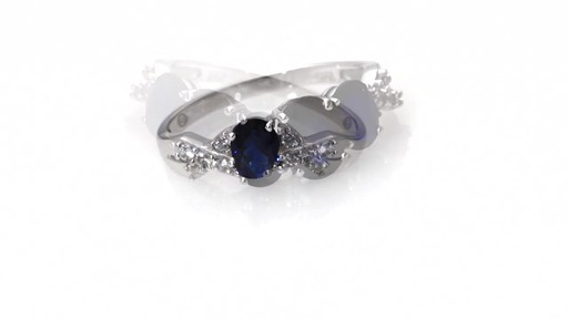 ZALES Oval Lab Created Blue and White Sapphire Three Stone Twist Ring in 10K