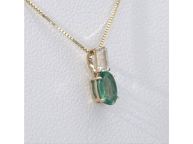 Oval Emerald and Baguette-Cut White Topaz Pendant in 10K Gold - image 10 from the video