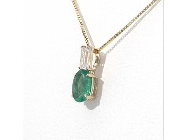 Oval Emerald and Baguette-Cut White Topaz Pendant in 10K Gold - image 2 from the video