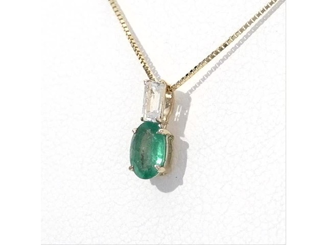 Oval Emerald and Baguette-Cut White Topaz Pendant in 10K Gold - image 3 from the video