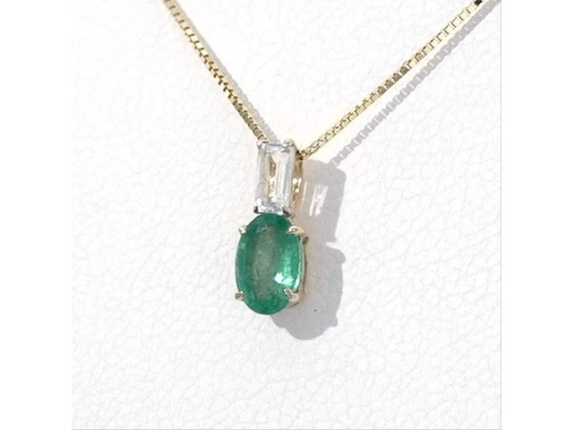Oval Emerald and Baguette-Cut White Topaz Pendant in 10K Gold - image 4 from the video
