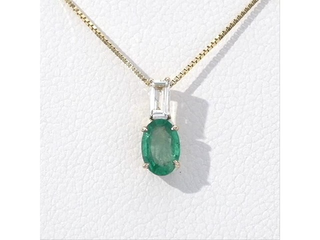 Oval Emerald and Baguette-Cut White Topaz Pendant in 10K Gold - image 6 from the video