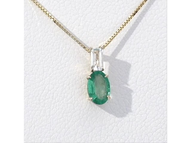 Oval Emerald and Baguette-Cut White Topaz Pendant in 10K Gold - image 7 from the video