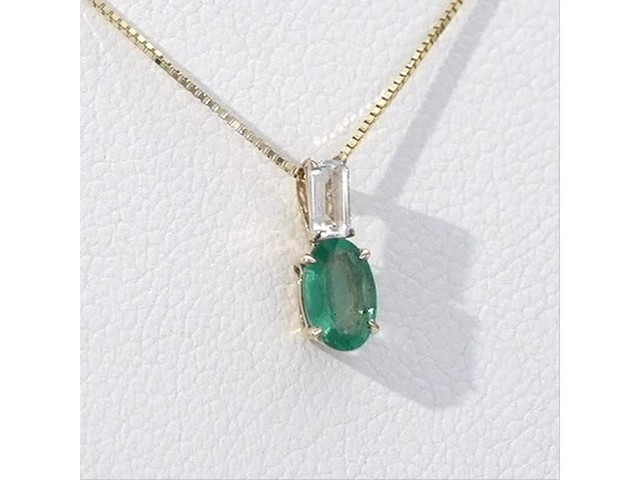 Oval Emerald and Baguette-Cut White Topaz Pendant in 10K Gold - image 8 from the video