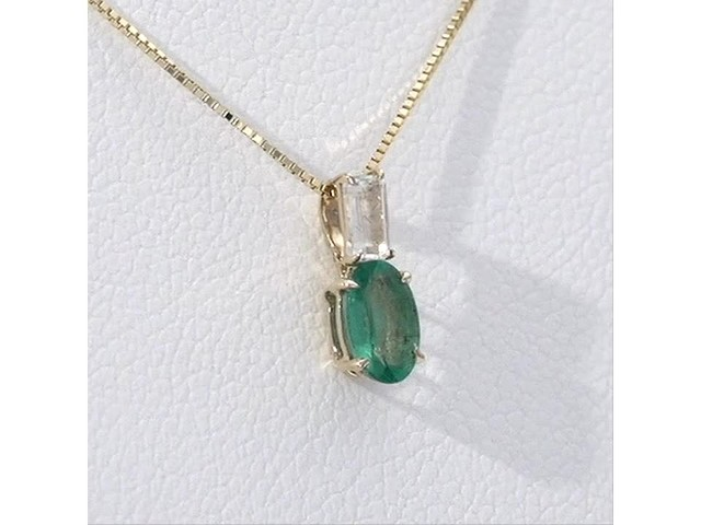 Oval Emerald and Baguette-Cut White Topaz Pendant in 10K Gold - image 9 from the video