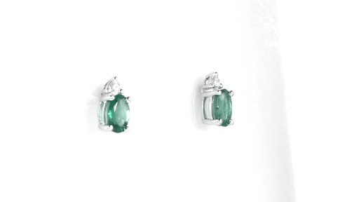 ZALES Oval Emerald and Diamond Accent Stud Earrings in 10K White Gold, Girl's, Size: regular - image 1 from the video