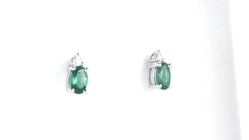 ZALES Oval Emerald and Diamond Accent Stud Earrings in 10K White Gold, Girl's, Size: regular - image 2 from the video