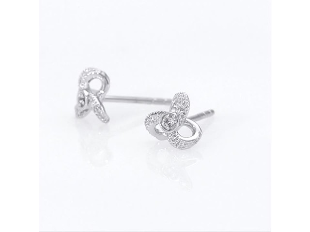 Diamond Accent Flower Stud Earrings in 10K White Gold - image 7 from the video