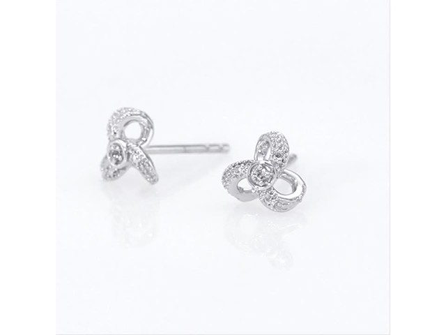 Diamond Accent Flower Stud Earrings in 10K White Gold - image 8 from the video