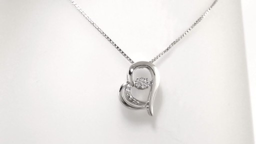 Diamonds In Motion Diamond Accent Tilted Heart Pendant In