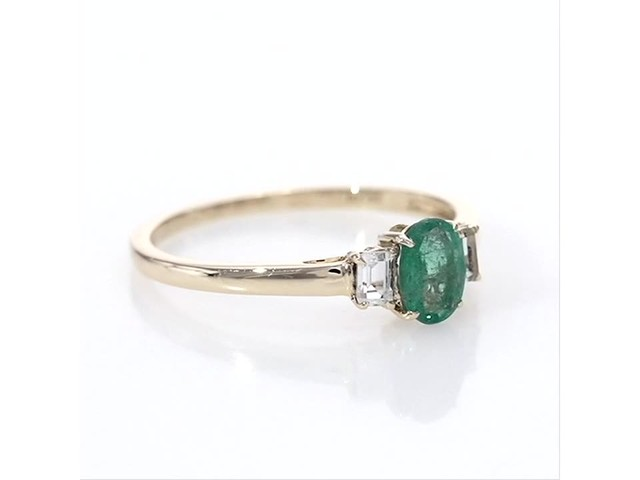 Oval Emerald and Baguette-Cut White Topaz Three Stone Ring in 10K Gold - image 1 from the video