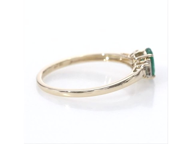 Oval Emerald and Baguette-Cut White Topaz Three Stone Ring in 10K Gold - image 10 from the video