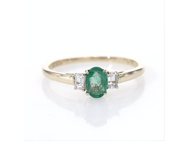 Oval Emerald and Baguette-Cut White Topaz Three Stone Ring in 10K Gold - image 2 from the video