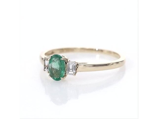 Oval Emerald and Baguette-Cut White Topaz Three Stone Ring in 10K Gold - image 3 from the video