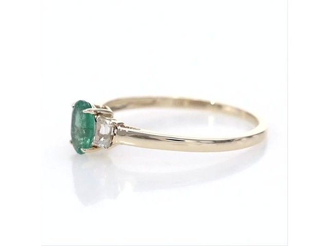 Oval Emerald and Baguette-Cut White Topaz Three Stone Ring in 10K Gold - image 4 from the video