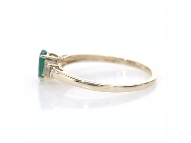 Oval Emerald and Baguette-Cut White Topaz Three Stone Ring in 10K Gold - image 5 from the video