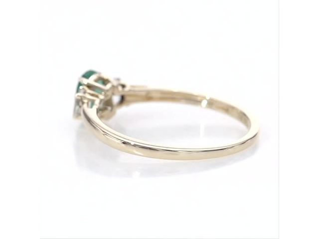 Oval Emerald and Baguette-Cut White Topaz Three Stone Ring in 10K Gold - image 6 from the video