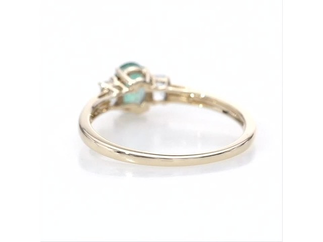 Oval Emerald and Baguette-Cut White Topaz Three Stone Ring in 10K Gold - image 7 from the video
