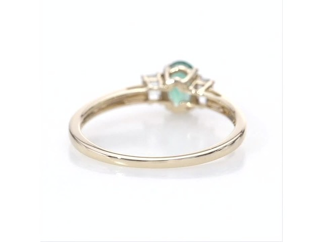 Oval Emerald and Baguette-Cut White Topaz Three Stone Ring in 10K Gold - image 8 from the video