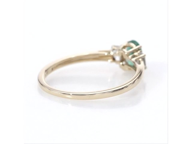 Oval Emerald and Baguette-Cut White Topaz Three Stone Ring in 10K Gold - image 9 from the video
