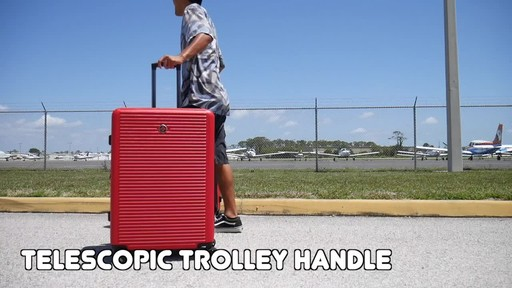 Proton Surge Hardside Spinner Luggage Collection - image 10 from the video
