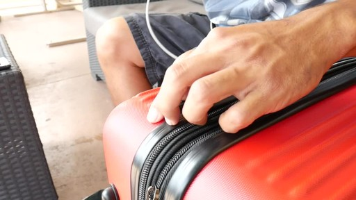 Proton Surge Hardside Spinner Luggage Collection - image 4 from the video