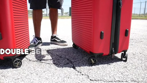 Proton Surge Hardside Spinner Luggage Collection - image 7 from the video