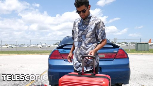 Proton Surge Hardside Spinner Luggage Collection - image 9 from the video