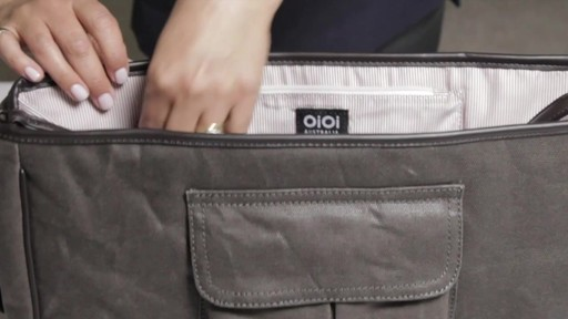 OiOi Crushed Wax Canvas Messenger Diaper Bag - eBags.com - image 3 from the video