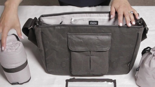 OiOi Crushed Wax Canvas Messenger Diaper Bag - eBags.com - image 4 from the video