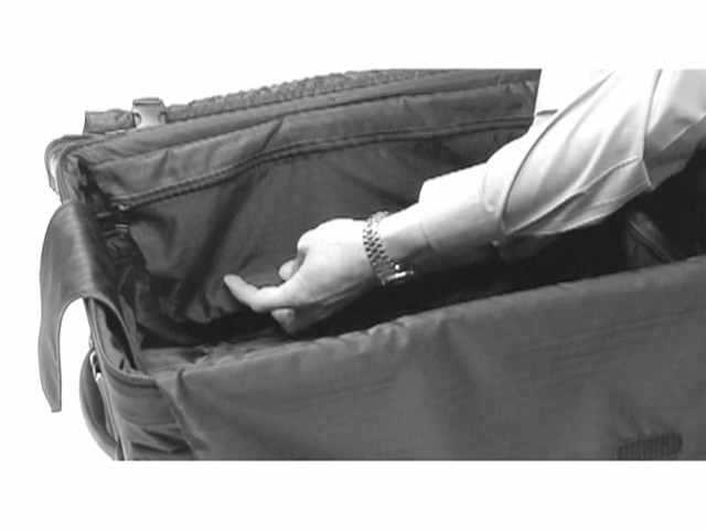 TUMI - How to Use Push-Button Expansion - image 7 from the video