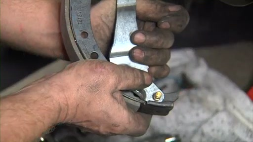 Wearever Changing Drum Brakes Step 3 - Transfer the Pin and Install Parking Brake FR538 - image 6 from the video