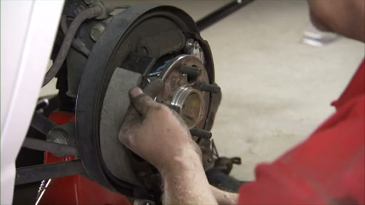 Wearever Changing Drum Brakes Step 5 - Install the Anchor Spring and Leading Shoe FR514 - image 4 from the video