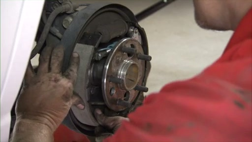 Wearever Changing Drum Brakes Step 5 - Install the Anchor Spring and Leading Shoe FR514 - image 5 from the video