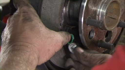 Wearever Changing Drum Brakes Step 5 - Install the Anchor Spring and Leading Shoe FR514 - image 9 from the video
