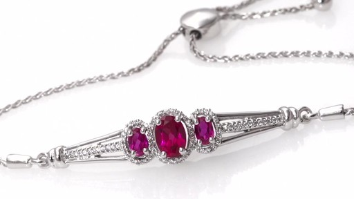 caeba8d505ef Oval Lab-Created Ruby and 0.18 CT. T.W. Diamond Three Stone Bolo Bracelet in
