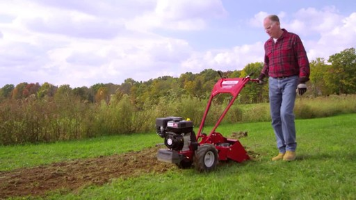 Troy-Bilt Vertical Tine Tiller - image 7 from the video