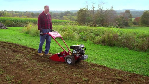 Troy-Bilt Vertical Tine Tiller - image 8 from the video