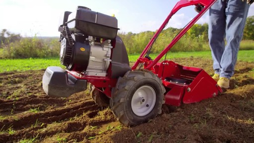 Troy-Bilt Vertical Tine Tiller - image 9 from the video