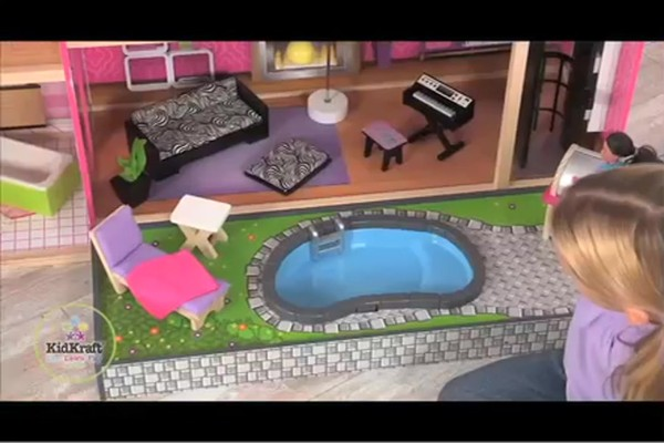 KidKraft Luxury Uptown Mansion Dollhouse, 35-pc of Furniture - image 8 from the video
