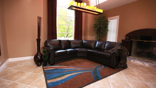 Santa Monica Top Grain Leather Sectional and Ottoman - image 9 from the video