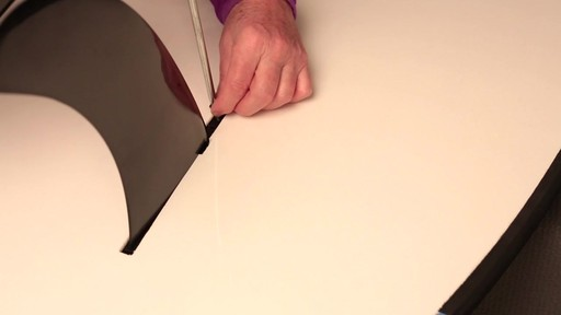 How to attach the fin to a Stand Up Paddleboard - image 6 from the video
